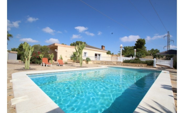 Fantastic one level villa with pool and garage.