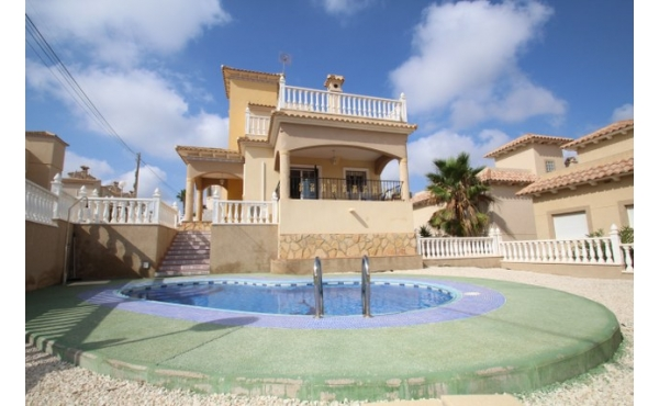 Detached villa with private pool and garage.