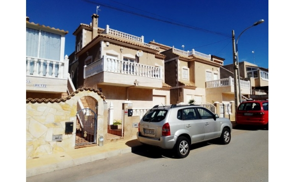 Detached villa with garage and communal pool.